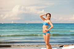 Happy woman with wind surf on the beach Stock Photo