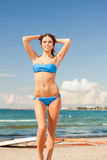 Happy woman with wind surf on the beach Stock Image