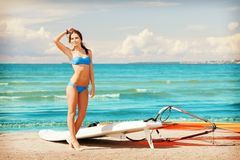Happy woman with wind surf on the beach Stock Images