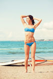 Happy woman with wind surf on the beach Royalty Free Stock Photo