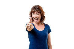Happy woman winking and giving a thumbs up Stock Photo