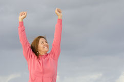 Happy woman in winning pose Stock Photo