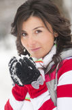 Happy woman in winter. Happy young woman in wintry gloves with snowball Stock Photo