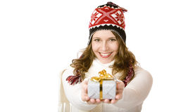 Happy woman with winter cap holds gift in hands. Young happy woman with cap is holding Christmas gift in hands. Isolated on white background with copyspace for Stock Image