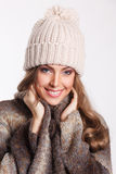 Happy woman at winter. Closeup of a happy smiling woman in winter cap Stock Photos