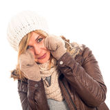 Happy woman in winter clothes. Young happy woman in winter clothes, isolated on white background Royalty Free Stock Images