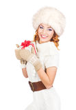 A happy woman in winter clothes holding a Christmas present Stock Image