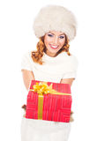 A happy woman in winter clothes holding a Christmas present Stock Photo