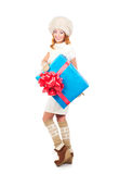 A happy woman in winter clothes holding a present Royalty Free Stock Image