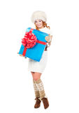 A happy woman in winter clothes holding a present Royalty Free Stock Photo