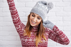 Happy woman in winter clothes raising hand Royalty Free Stock Images