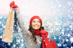Happy woman in winter clothes with shopping bags Stock Photo