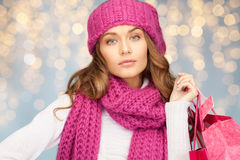 Happy woman in winter clothes with shopping bags. Holidays, christmas, sale and people concept - happy young woman in winter clothes with shopping bags over Royalty Free Stock Photography