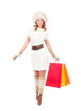 A happy woman in winter clothes with shopping bags Royalty Free Stock Images