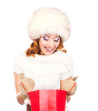 A happy woman in winter clothes with shopping bags Royalty Free Stock Photo