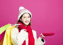 Woman in winter clothes and shopping for christmas gifts. Happy Woman in winter clothes and shopping for christmas gifts Royalty Free Stock Images