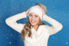 Happy woman in winter clothes with snow Stock Photography