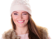 Happy woman in winter clothes winking Stock Images