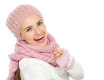 Happy woman in winter clothing pointing in camera Royalty Free Stock Photos