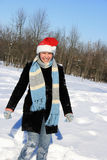 Happy woman in the winter forest Stock Photos