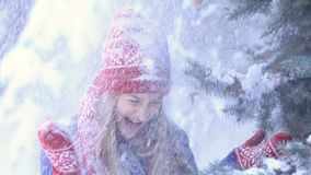 Happy woman in winter forest getting snow shower stock video footage