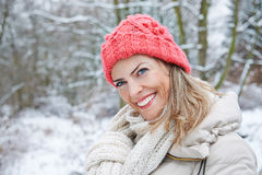 Happy woman in winter forest Royalty Free Stock Image