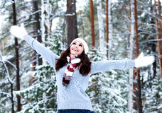 Happy woman in a winter forest Royalty Free Stock Photos