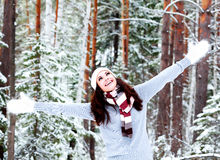 Happy woman in a winter forest Stock Photos