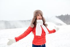 Happy woman in winter fur hat having fun outdoors Royalty Free Stock Photography