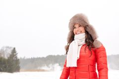Happy woman in winter fur hat outdoors Royalty Free Stock Image
