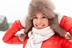 Happy woman in winter fur hat outdoors Stock Photography