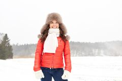 Happy woman in winter fur hat outdoors Stock Images