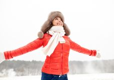 Happy woman in winter fur hat outdoors Royalty Free Stock Photo