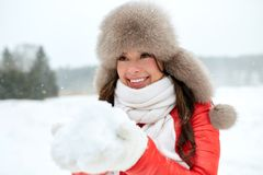 Happy woman in winter fur hat with snow outdoors. People, season and leisure concept - happy woman in winter fur hat with snow outdoors Royalty Free Stock Photos