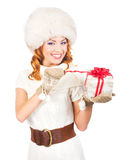 A happy woman in a winter hat holding a present Stock Photos