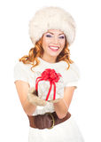 A happy woman in a winter hat holding a present Royalty Free Stock Photo
