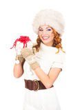 A happy woman in a winter hat holding a present Stock Photography