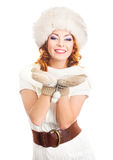 A happy woman in a winter hat isolated on white Royalty Free Stock Photography