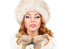A happy woman in a winter hat isolated on white Stock Photo
