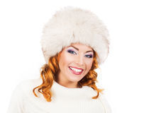 A happy woman in a winter hat isolated on white Royalty Free Stock Image