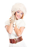 A happy woman in a winter hat isolated on white Royalty Free Stock Images
