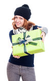 Happy woman in winter hat with present Stock Images