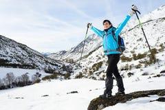 Happy woman winter mountain hiker Stock Photo
