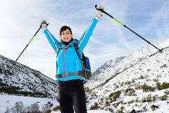 Happy woman winter mountain hiking Stock Photo