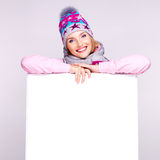 Happy woman in winter outerwear over white banner stock photo