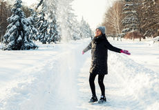 Happy woman in  winter park. Happy woman in a winter park Royalty Free Stock Photography