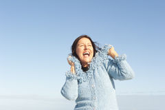 Happy woman winter sky  Royalty Free Stock Image