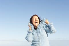 Happy woman winter sky  Royalty Free Stock Image