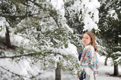 Happy woman in winter with snow. Looking blissful Royalty Free Stock Photo