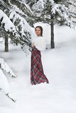 Happy woman in winter with snow. Looking blissful Royalty Free Stock Photos